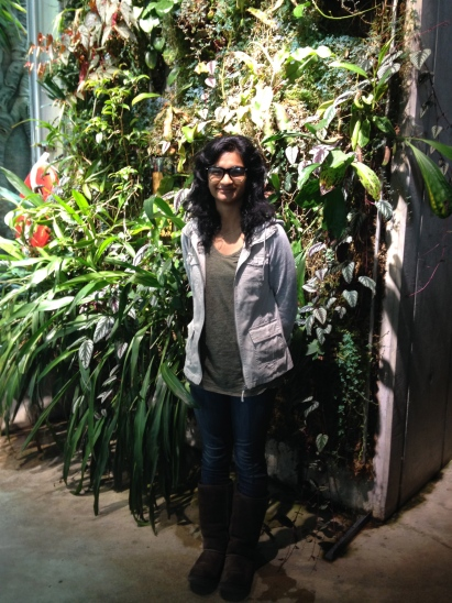 Yours truly smiling awkwardly in front of a living wall